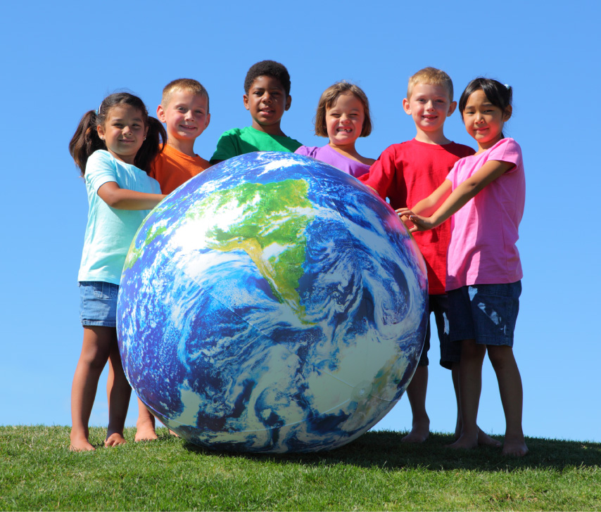 diverse children with large globe